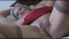 imagen Attractive bust granny in slip and stockings st…